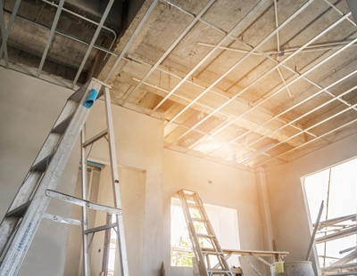 Install metal frame for plaster board ceiling at house under con